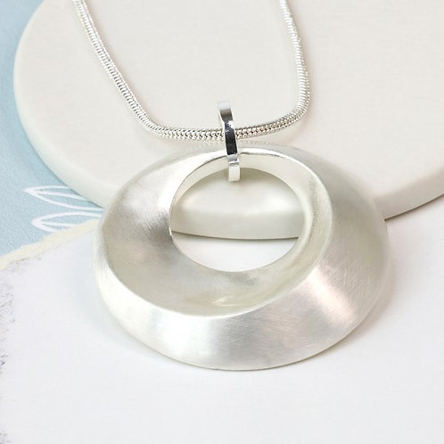 POM Silver plated swirl necklace in a worn finish