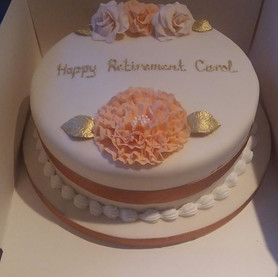 Peach and gold flower design retirement cake
