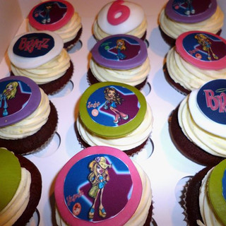 Bratz themed cupcakes toped with coloured sugarpaste discs and edible Bratz images
