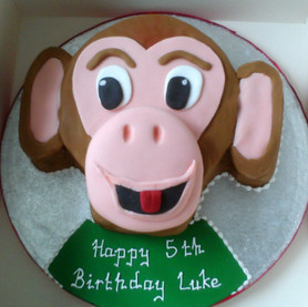 Novelty monkey face birthday cake