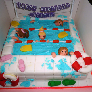 Novelty swimming pool party cake