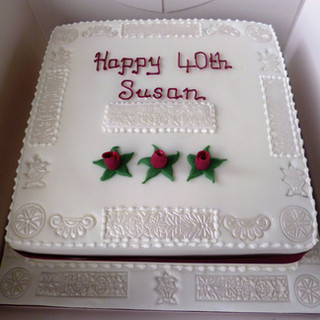 embossed design with maroon detail birthday cake