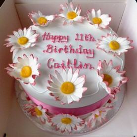 Pink and white daisy birthday cake