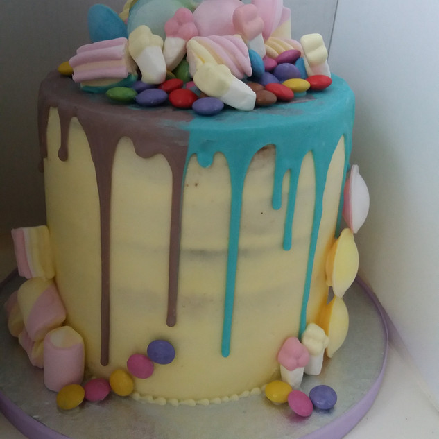 Drip cake with assorted sweets
