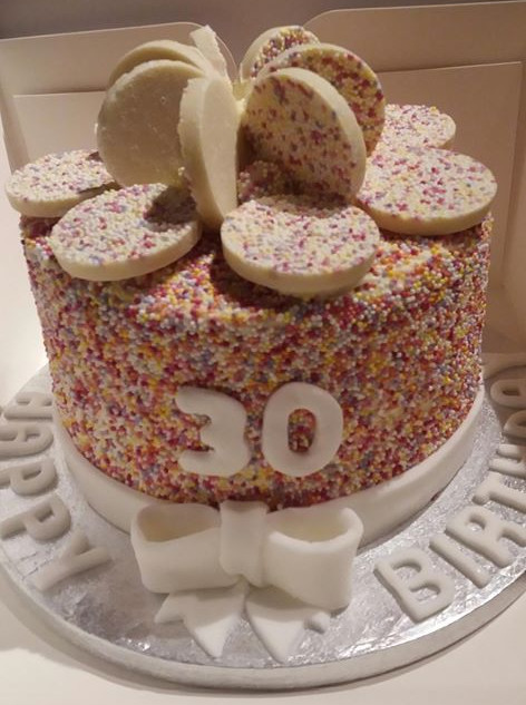 Giant jazzie hundred and thousands cake