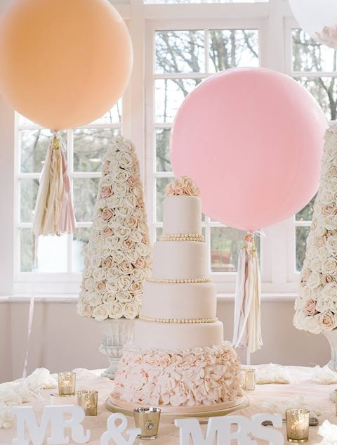 Blush coloured rose petal ruffle cake