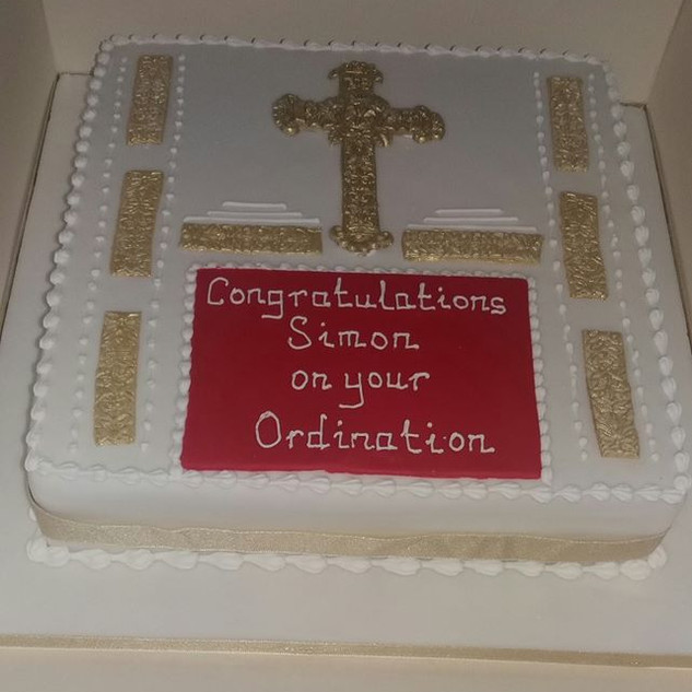 Embossed gold, red and white ordiantion cake
