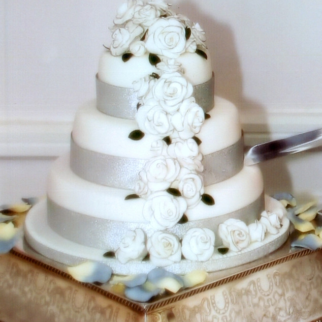 Cascading sugar roses 3 tier wedding cake