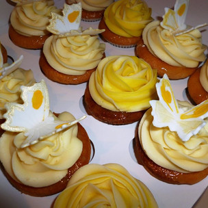 Rose buttercream cupcakes with butterfly decorations