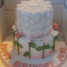 2 tier rosebud and daisy birthday cake