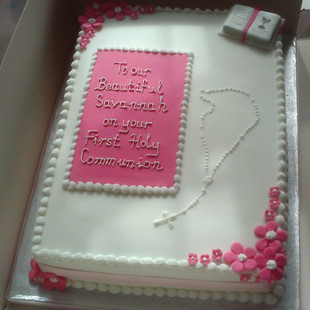 Communion cake with pink and white