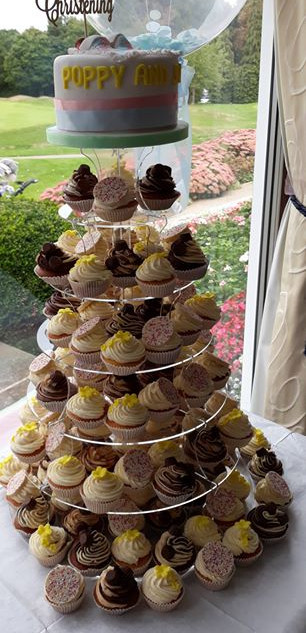 """Assorted cupcakes tower topped with a 6"""" cake"""