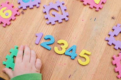 two year boy plays with Foam Puzzle Mat
