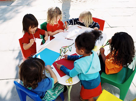 Children drawing at a table