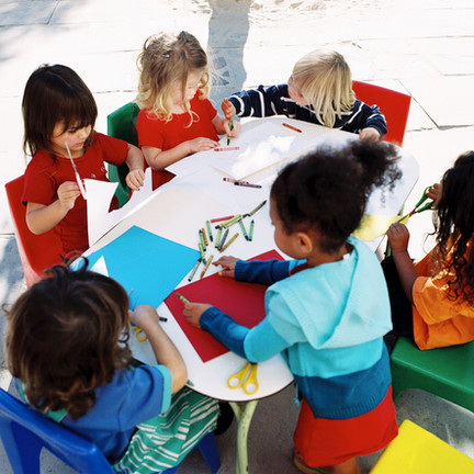 Childcare Services | Children Coloring at a Table | Lake Country Childcare | Pewaukee