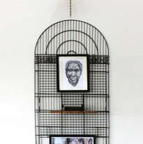 The Wealth of the Nation, 2021. A collaborative project by Ursula Christel (NZ) and Masud Olufani (USA).  Wall installation Repurposed metal birdcage and brass bell, 2 framed digital prints, NZ native timber, cut and burned copy of Adam Smith's 'The Wealth of Nations' (first published in 1776), twine, shellac