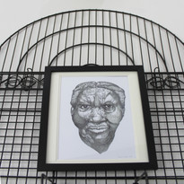 Installation detail: Bronze bell with birdcage and portrait drawing (2019) by Masud Olufani  Image: Ursula Christel