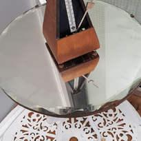 Inorganic Collection, 2018 Found garden table, found mirror, chain, vintage metronome 86 x 69 x 69cm