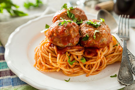 Meat balls and spaghetti on white plate,