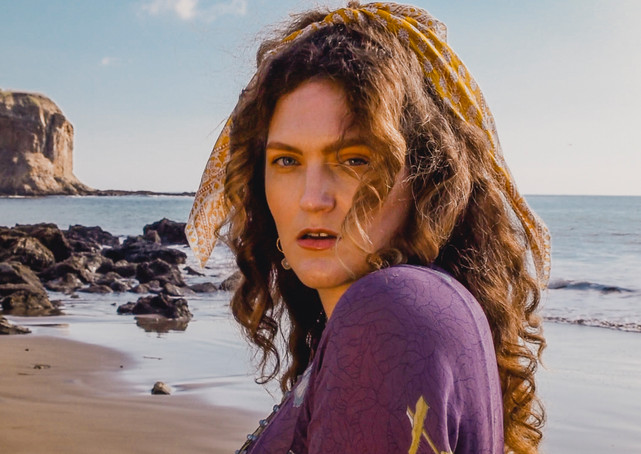 Musician and songwriter Christina Lyon poses on the beach in Palos Verdes