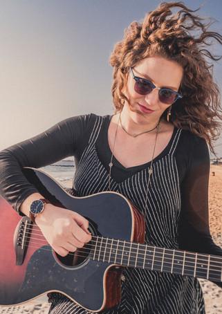 Christina Lyon playing the guitar