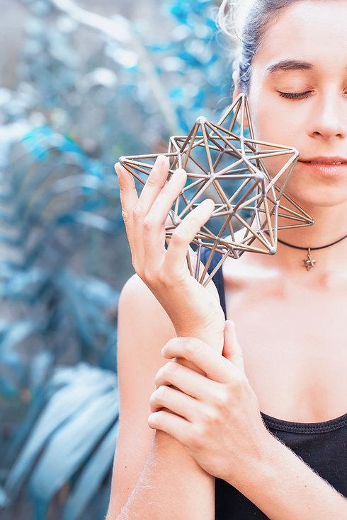 Woman meditating on sacred geometry.jpg