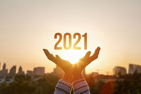 Hands show New Year 2021 against the bac