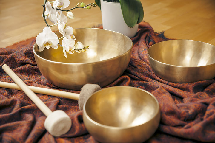 An image of some singing bowls and a whi