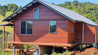 Eltham house gets a roof and Jarrah cladding