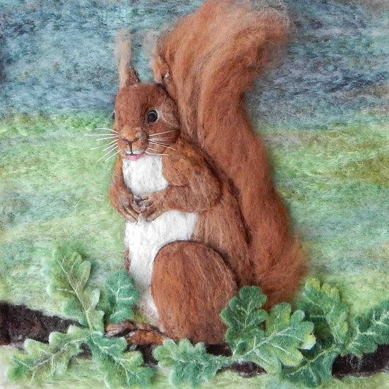 Fibre art portrait of a red squirrel sitting up