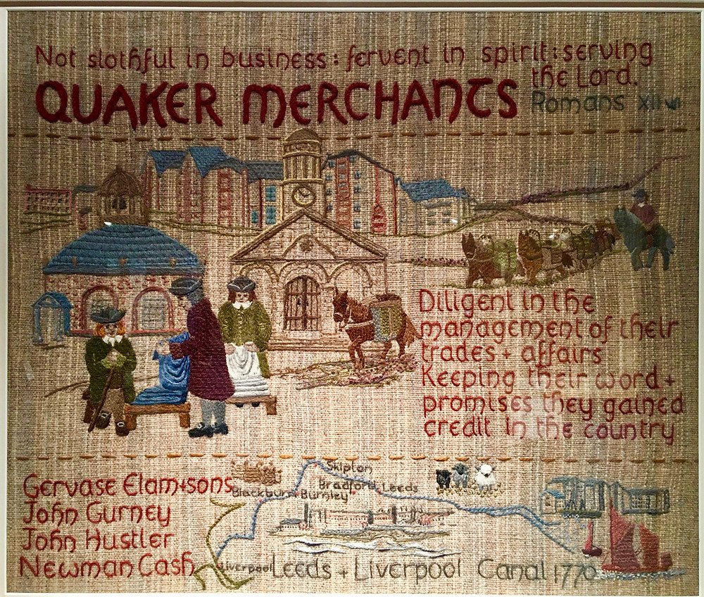 Photo of a tapestry in the Quaker Tapestry Museum in Kendal, showing Cumbrian Fell ponies in packhorse trains carrying wool.