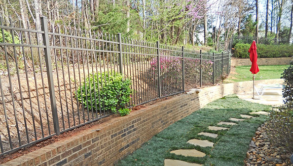 Bronze Aluminum Fence installed behind a wall