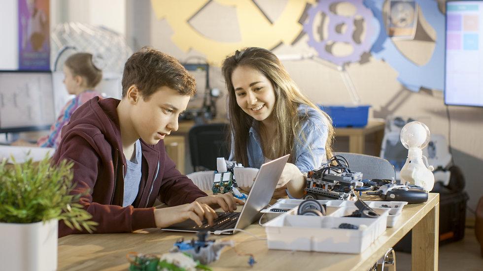 Girl and Boy Program Cute Little Robot w