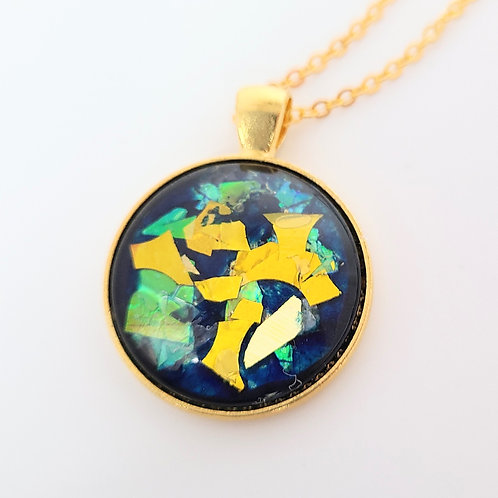 Blue And Gold Pendant by Elizabeth Ostwald