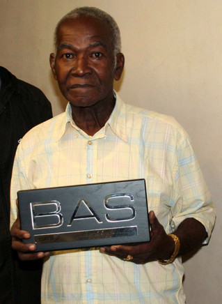 Cyprian 'Cy' Jean-Jacques with award - RIP (Sept '37 - Aug '10)