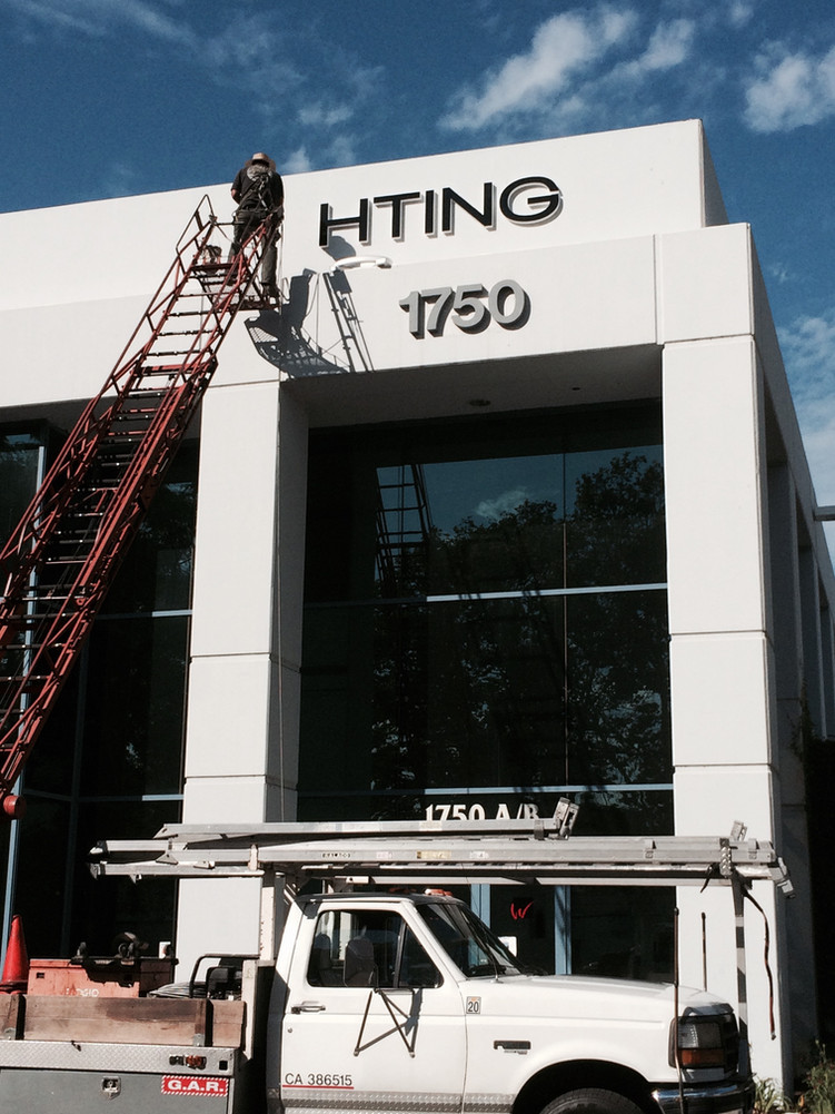 Building Wall Sign Instalation