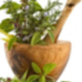 Herbs in wooden bowl