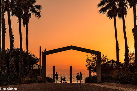 People walking at the beach at sunset time