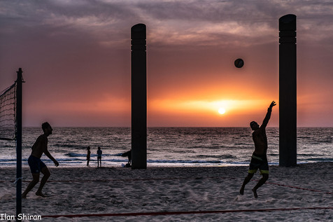 Mans play with a ball at the beach
