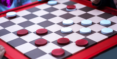 A game of checkers is powered by Knowledge Bridge, a state-of-the-art product configuration platform.