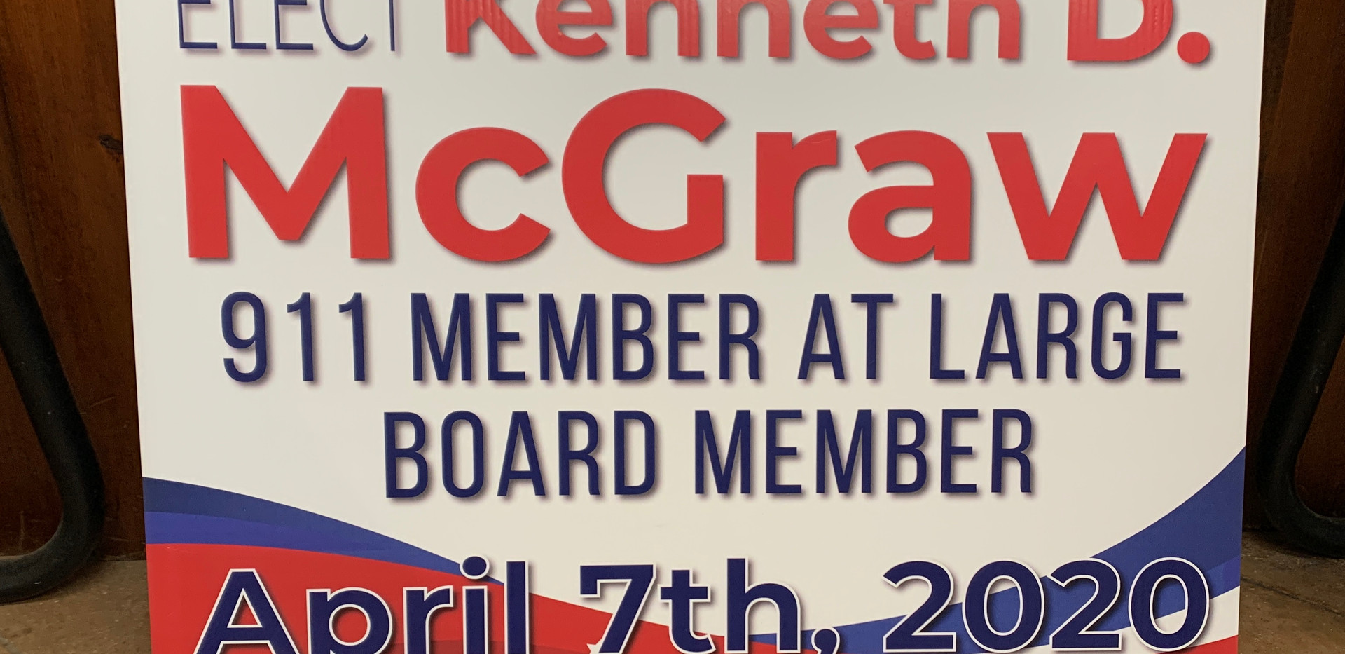 911 board member election sign