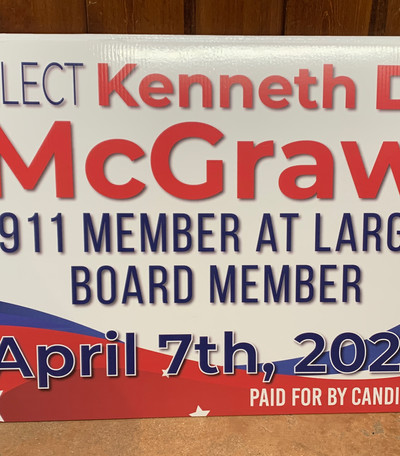 911 board member election sign