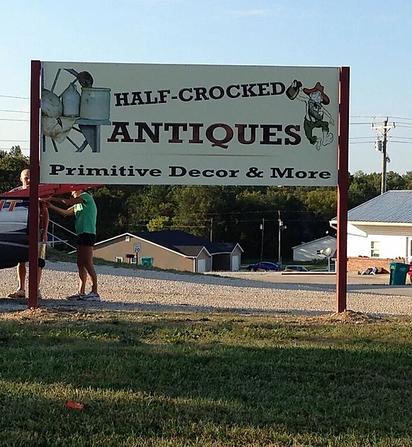Half-Crocked Antiques Sign