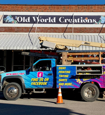 Old World Creations Building Sign
