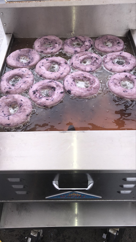 Blueberry donuts in fryer