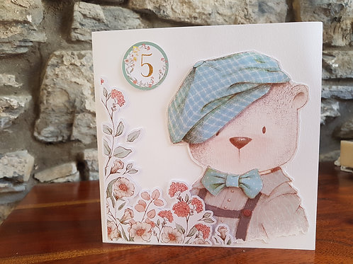 Children birthday card with cute Teddy with a hat