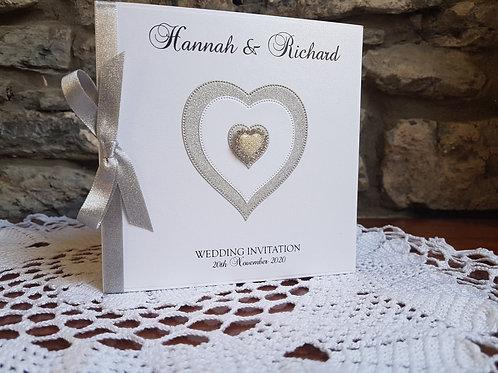 White pocketfold Wedding invitation with silver glitter heart