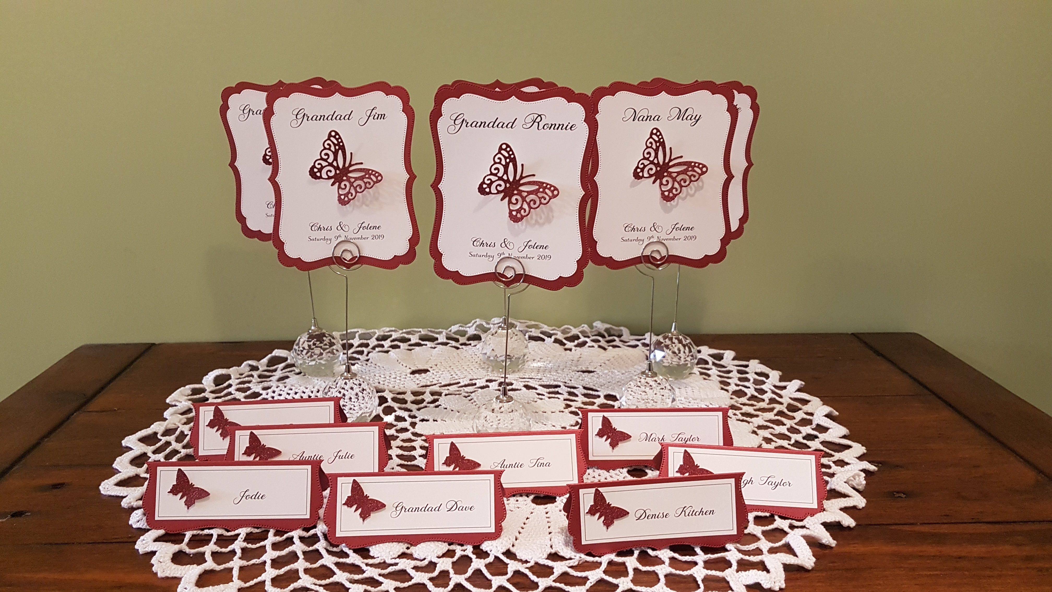 Burgundy and white table Name card and p
