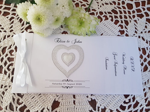 White Cheque Book wedding invitation with silver glitter heart design