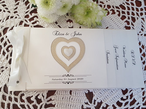Ivory cheque book wedding invitation with gold glitter heart embellishment